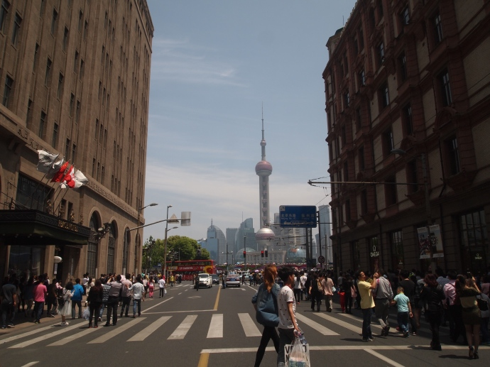 First view of the Oriental Pearl TV Tower in Pudong from Nanjing Lu