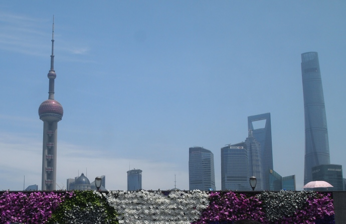 Looking across the walkway along the Huangpu River to flashy Pudong