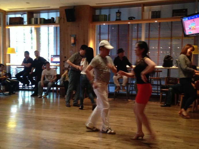Chinese folks doing salsa