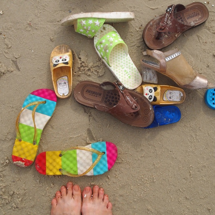 beach shoes and bare feet