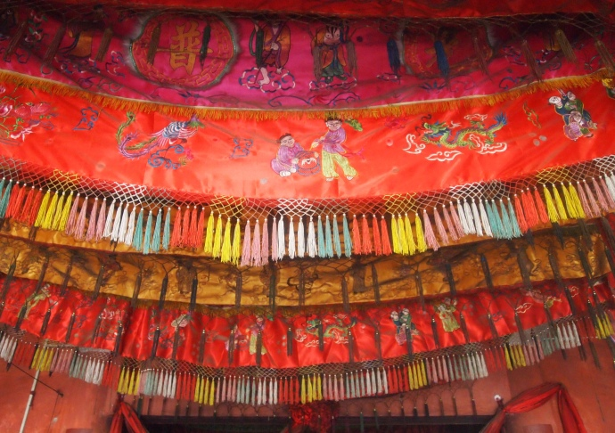 colorful banners on the ceiling in Sanpo Temple