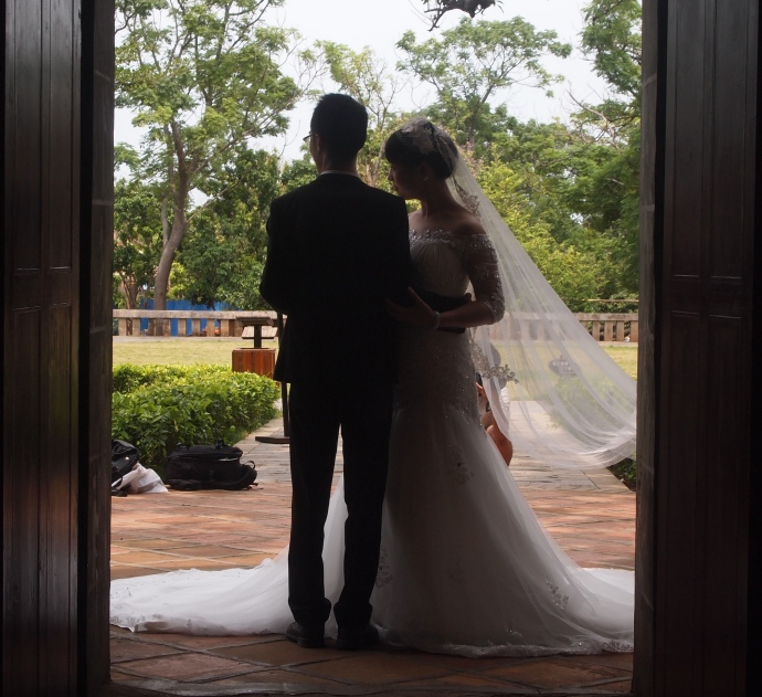 Bride and groom at Catholic Cathedral, Shèngtáng