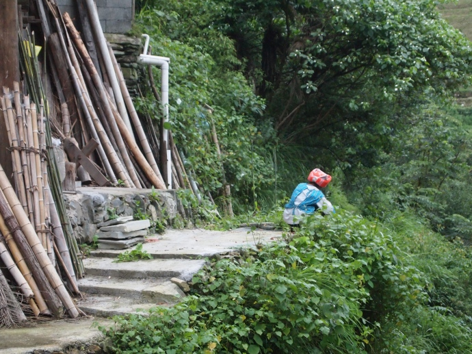 a woman at work in the garden in Ping'an Village