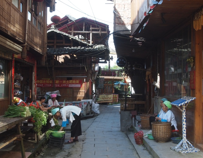 ladies preparing vegetables in the streets of Ping'An