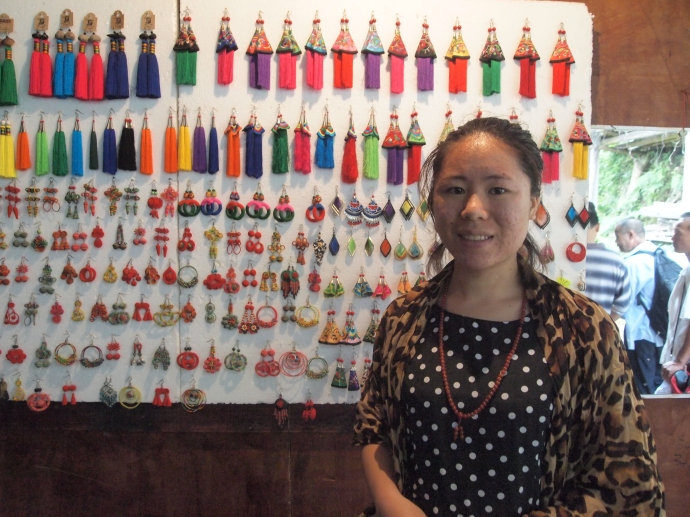 a vendor selling colorful earrings